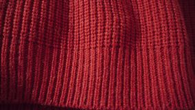 Red wool or acrylic background knitted texture. Can be used as background. Red wool or acrylic background knitted texture. Warm scarf or sweater for the winter stock video