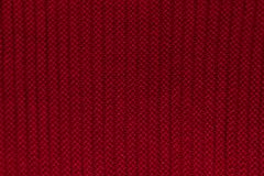Red wool knitted background. Red wool background with stripes royalty free stock images