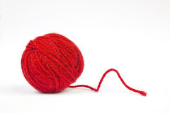 Red wool ball. In a white background Stock Photo