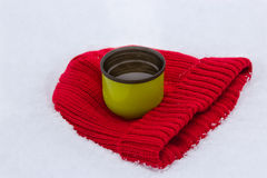 Red wool hat and green thermos mug Stock Photography