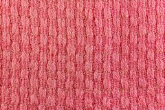 Red wool knitted texture closeup. Natural wool fabric background Stock Image