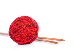 Red wool and knitting needles Royalty Free Stock Photography
