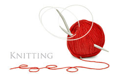 Red wool and knitting needles Royalty Free Stock Photos