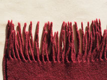 Red wool scarf with fringes. Red wool scarf winter wear with fringes Royalty Free Stock Image