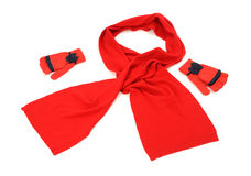 Red wool scarf, a pair of gloves nicely arranged. Royalty Free Stock Photos