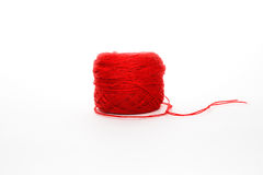 Red wool skein, knitting thread roll, isolated on white backgrou Royalty Free Stock Images