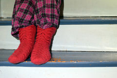 Red wool socks. And old worn stairs Royalty Free Stock Images