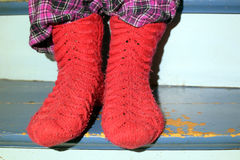Red wool socks. And old worn stairs Royalty Free Stock Photos