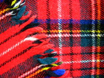 Red Wool Tartan Fabric. Macro photo of Red Woolen tartan fabric Royalty Free Stock Photos
