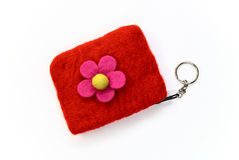 Red woolen purse on white. Woman red woolen purse on white background Royalty Free Stock Image