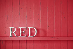 Red Word Background. A red painted wood background with the word red Stock Photography
