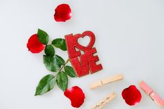 Red word LOVE and rose on white. Background stock photography