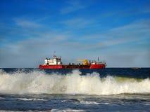 Red Workboat in Ocean Stock Image