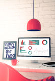 Red workspace with computer showing business graphics Royalty Free Stock Photo
