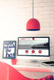 Red workspace with computer showing web design Stock Photography