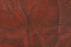Red worn out leather Royalty Free Stock Photos