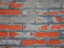 Red Worn Repaired Brickwall with Uneven Mortar Stock Image