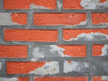 Red Worn Repaired Brickwall with Uneven Mortar Stock Photography