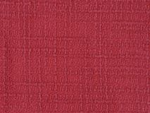 Woven Red Acrylic Fabric Up Close Detail. A red, woven acrylic fabric design is shown in a closeup view royalty free stock image