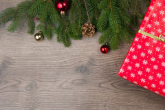 Red wraping gift with christmas tree Royalty Free Stock Photo