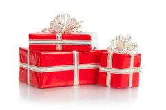Red wrapped gift with a bow on a white background Stock Images