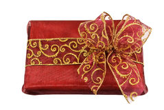 Red wrapped gift box with a bow Stock Photography
