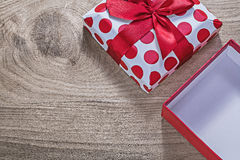 Red wrapped present box with tape on wooden board celebrations c. Oncept Royalty Free Stock Image
