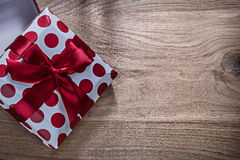Red wrapped present box on wooden board horizontal image celebra. Tions concept Stock Photos