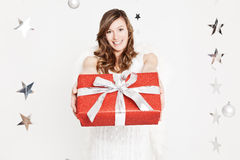 Red wrapped present given by an angel Royalty Free Stock Photos