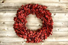 Red Wreath on vintage wood for the holidays Royalty Free Stock Image