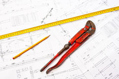 Red wrench on blueprints Stock Photos