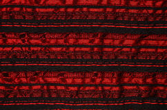 Red wrinkled cloth. Crumpled fabric with red horizontal stripes, closeup Royalty Free Stock Photography