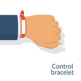 Red wristband on hand man Royalty Free Stock Photography