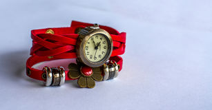 Red Wristwatch. Metallic hand watch with red leather bracelet and metallic flower ornament Stock Photography