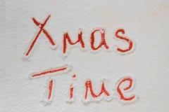 Written `XMas time` on the snow Stock Photos