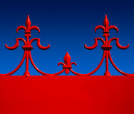 Red wrought iron fleur de lys against graduated bl Royalty Free Stock Image