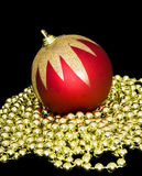 Red xmas ball. Christmas ball ornaments and beads, a black background Royalty Free Stock Image