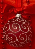 Red xmas ball. With beautiful bow on the silk Stock Images