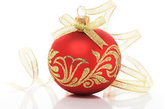 Red xmas ball and golden ribbon on white background Royalty Free Stock Images