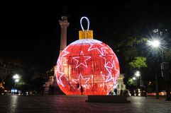 Christmas Lisbon, Lighted Red Ball with White Stars, Xmas Stock Photo