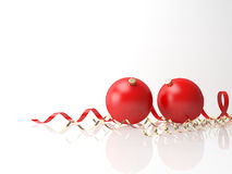 Red Xmas balls and scrolls on white background Stock Image