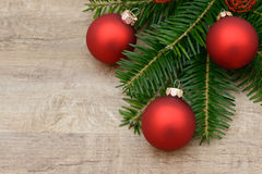 Red xmas bauble and fir branch Stock Photography