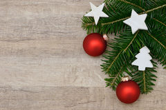Red xmas bauble and fir branch Royalty Free Stock Image