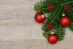 Red xmas bauble and fir branch Stock Image