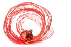 Red Xmas bauble in a red ribbon Spiral. Red Christmas bauble in a red ribbon Spiral Stock Images