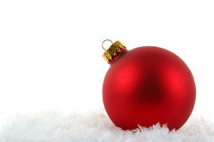 Red Xmas Bauble in the Snow Royalty Free Stock Photography