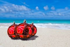 Red Xmas or christmas balls paradise beach. Red Xmas or christmas balls on paradise beach Stock Photos