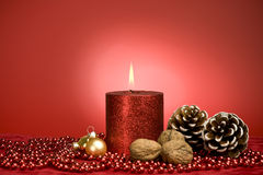 Red xmas decoration with candle Stock Image
