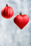 Red Xmas decorations on silver bokeh background. Merry Christmas and Happy New Year Royalty Free Stock Photo