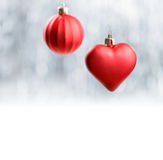 Red Xmas decorations on silver bokeh background. Merry Christmas and Happy New Year Royalty Free Stock Image
